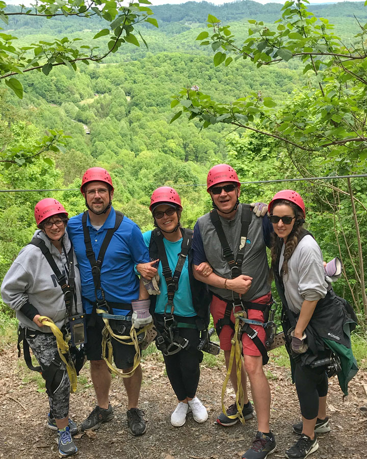 Dana, Leon, Peggy, David and Christina of Omega Commercial Interiors zip lining at the New River Gorge.