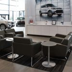Freedom KIA Dealership-Lounge chairs and side tables- designed by Omega Commercial Interiors