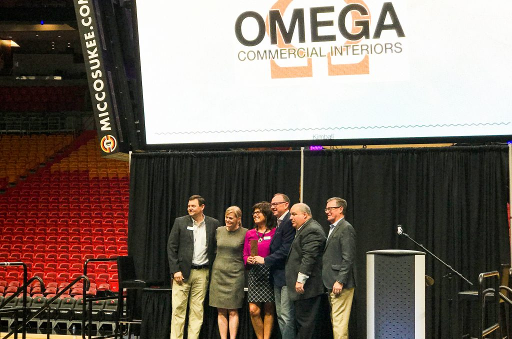 Mike Wagner (President of Kimball), Kristi Juster (Chief Executive Officer of Kimball), David McCormick (Owner/President of Omega Commercial Interiors), Peggy Schifano Lovio (Co-Owner/Vice President of Omega Commercial Interiors), Greg Richards (Director of Distribution for Kimball) and Don Van Winkle (Chief Operating Officer for Kimball) at Kimball Select Dealer Meeting- American Airlines Arena, Miami