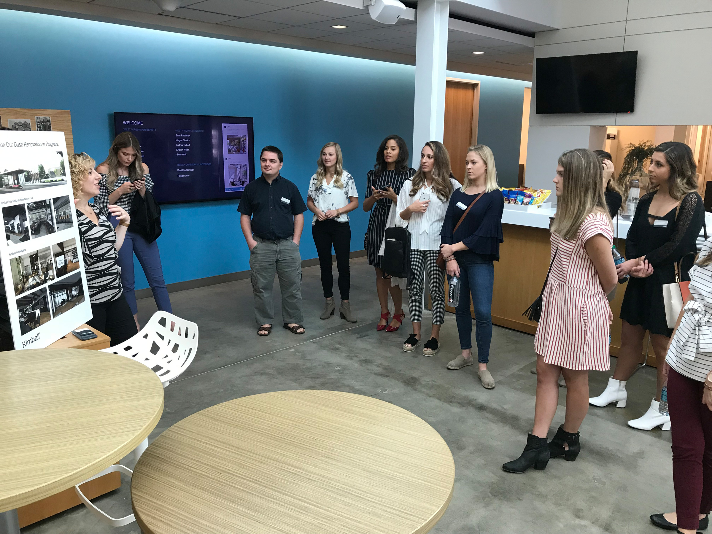 Rebecca Williams, a Kimball Sales Representative speaks to WVU School of Interior Design Students and Omega Commercial Interiors at Kimball Office in Jasper, Indiana
